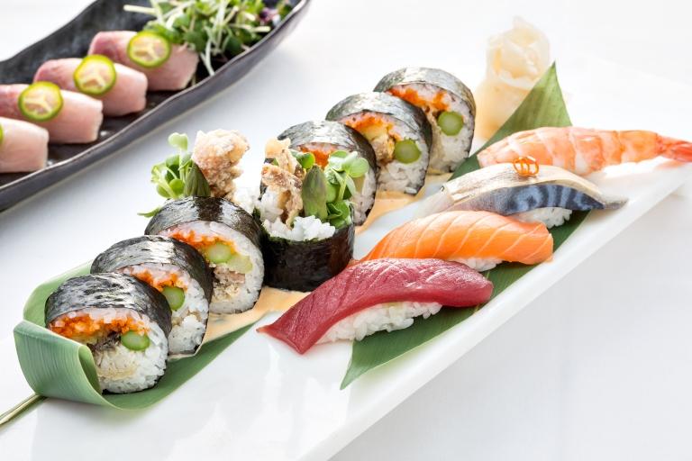Spider roll alongside yellowfin tuna, salmon, sabi and ebi nigiri